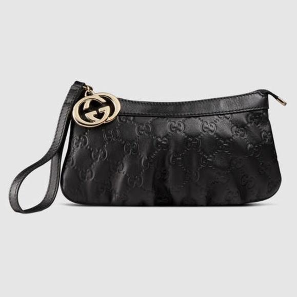 fe8d6af81e2 Gucci Handbags - Authentic Gucci Guccissima Black Wristlet Clutch